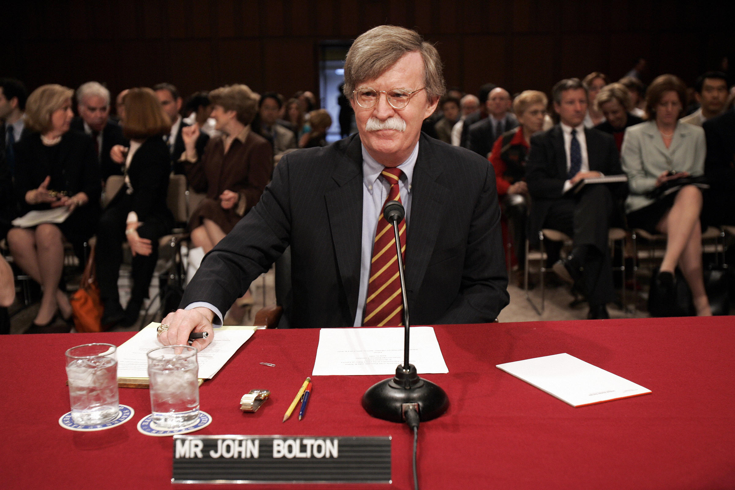 John Bolton takes his seat before a confirmation hearing of the Senate Foreign Relations Committee on Capitol Hill April 11, 2005 in Washington  for his nomination as US ambassador to the United Nations.
