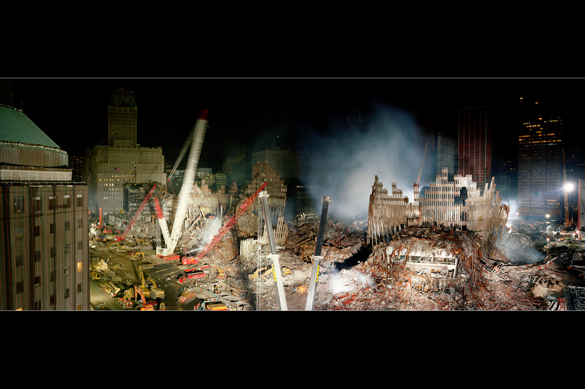A panorama looking northeast across Ground Zero made two weeks after the terrorist attacks on Sept. 11, 2001.  Meyerowitz assembled the image from multiple frames he had made on the ninth floor of the World Financial Center