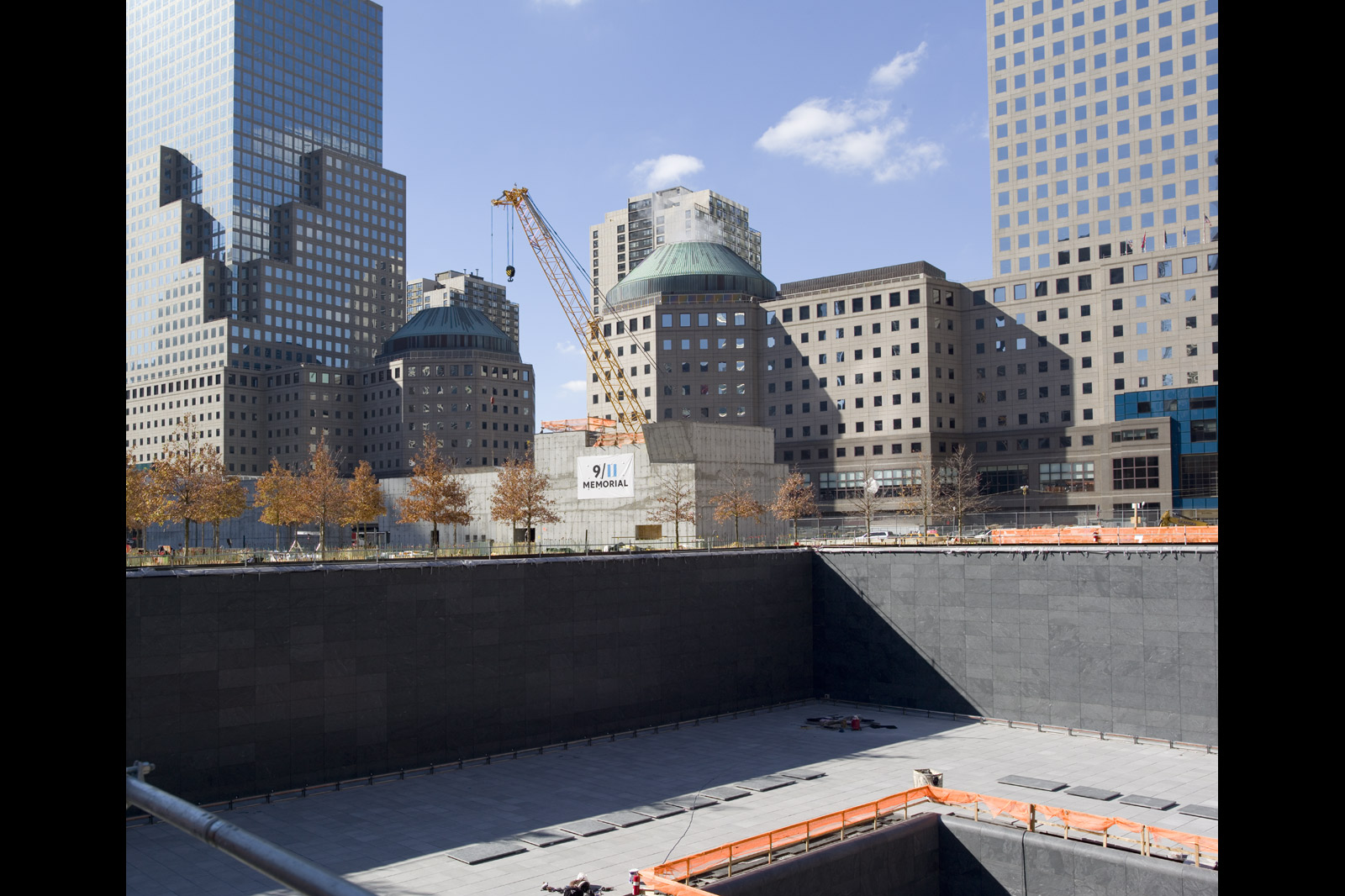 From a similar vantage point, Meyerowitz made this photograph shortly after white oaks had been planted on the site as part of the 9/11 memorial