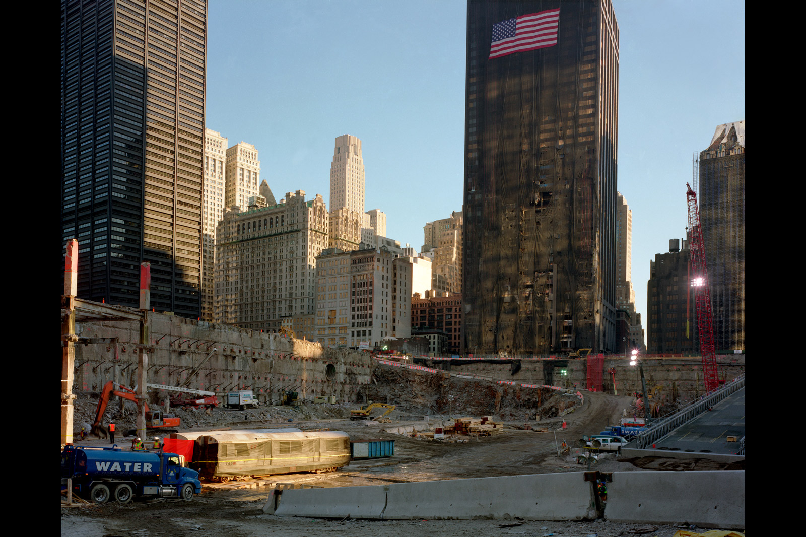 Meyerowitz framed the Deutsche Bank building (with flag) and the  ghost train  in this shot made from below street level, looking south, in February 2002