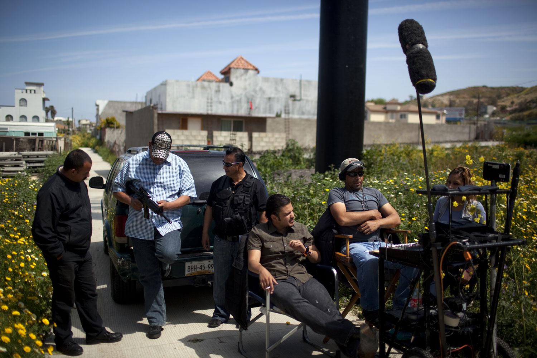 Big Hits                               Actors wait during the filming of Las Aguilas Andan Solas
