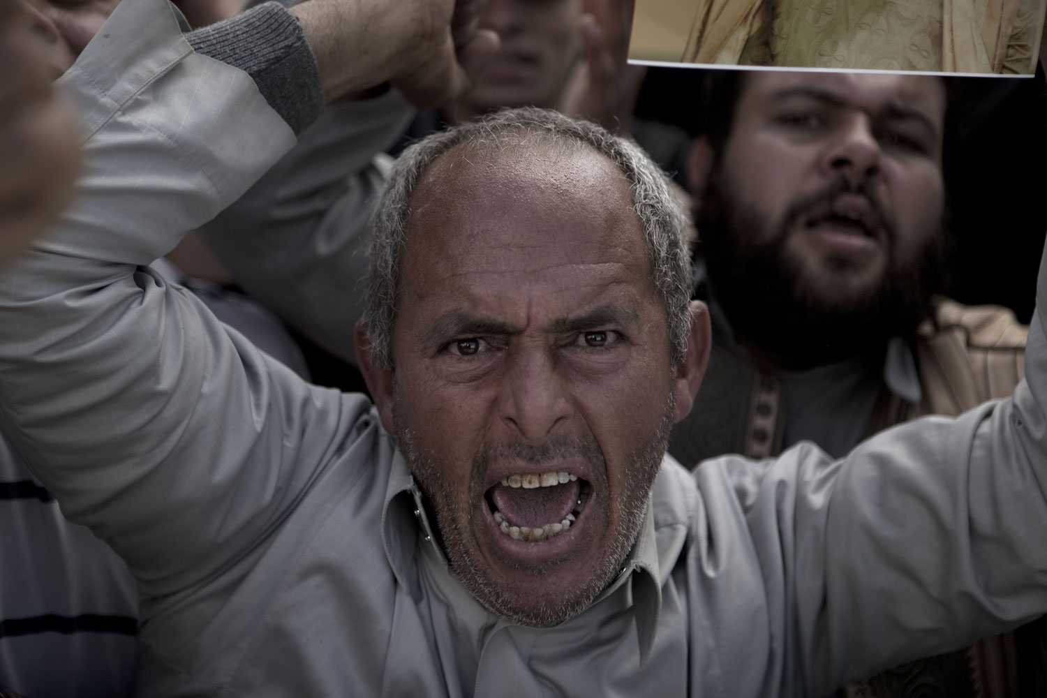 Supporters of Gaddafi vent their anger towards the foreign media in Ban-Waled, March 23, 2011.