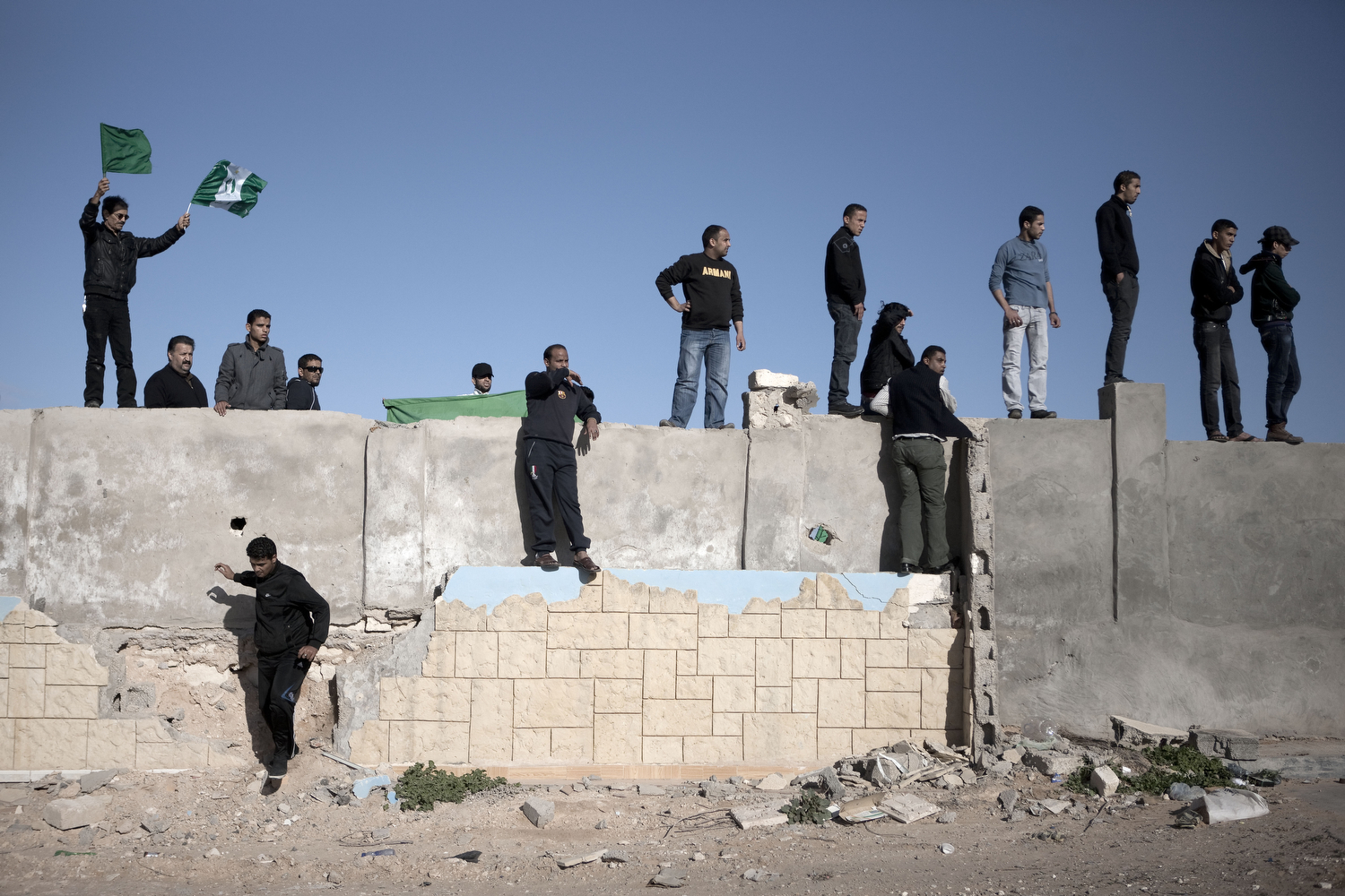 Men await the arrival of bodies, March 20, 2011.