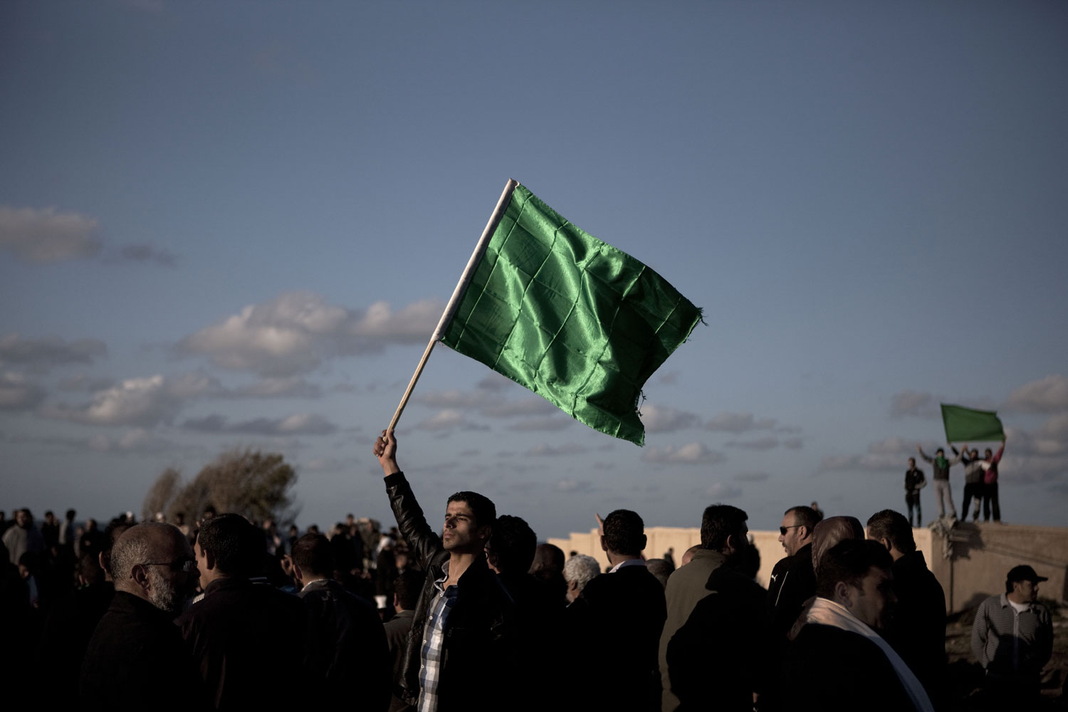 Loyalists express their support for Gaddafi in the cemetery, March 20, 2011.