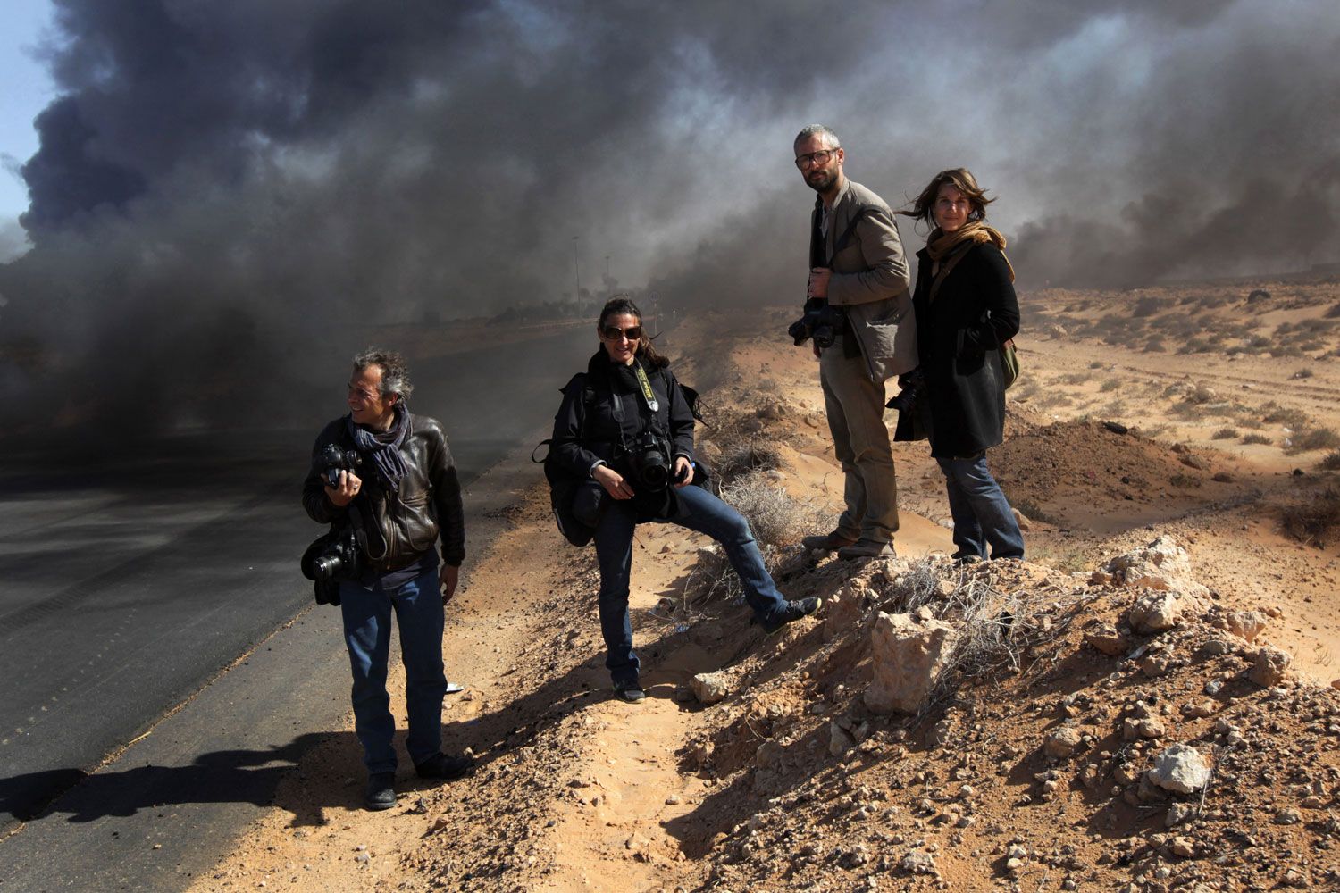 TIME contract photographer Yuri Kozyrev, Lynsey Addario, Tyler Hicks and Nicki Sobecki in Ras Lanuf, Libya, March 11, 2011.