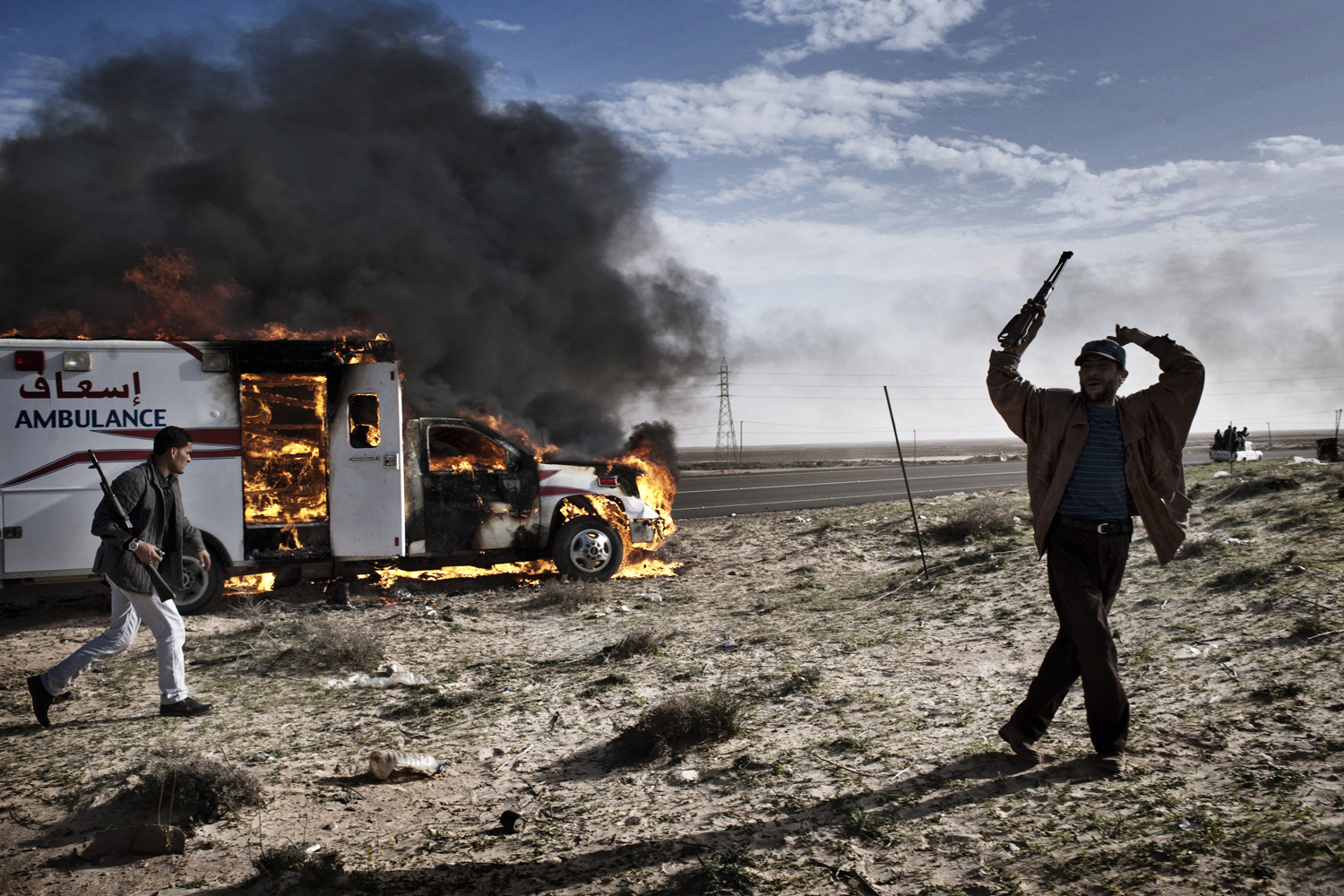 An ambulance burns after a battle between rebels and the Libyan army in Brega, March 2, 2011.