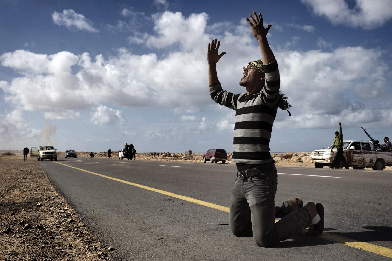 A Libyan rebel prays near the front line in Bin Jawad, March 6, 2011.