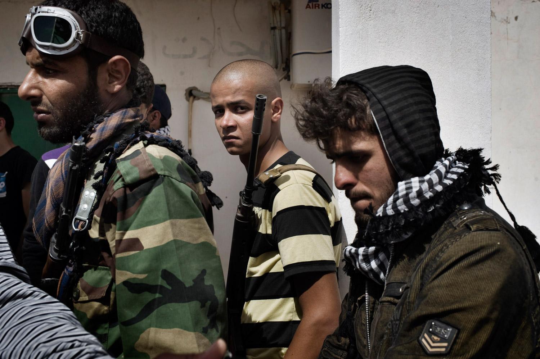 Libyan rebel soldiers gather near Bin Jawad, March 28, 2011.