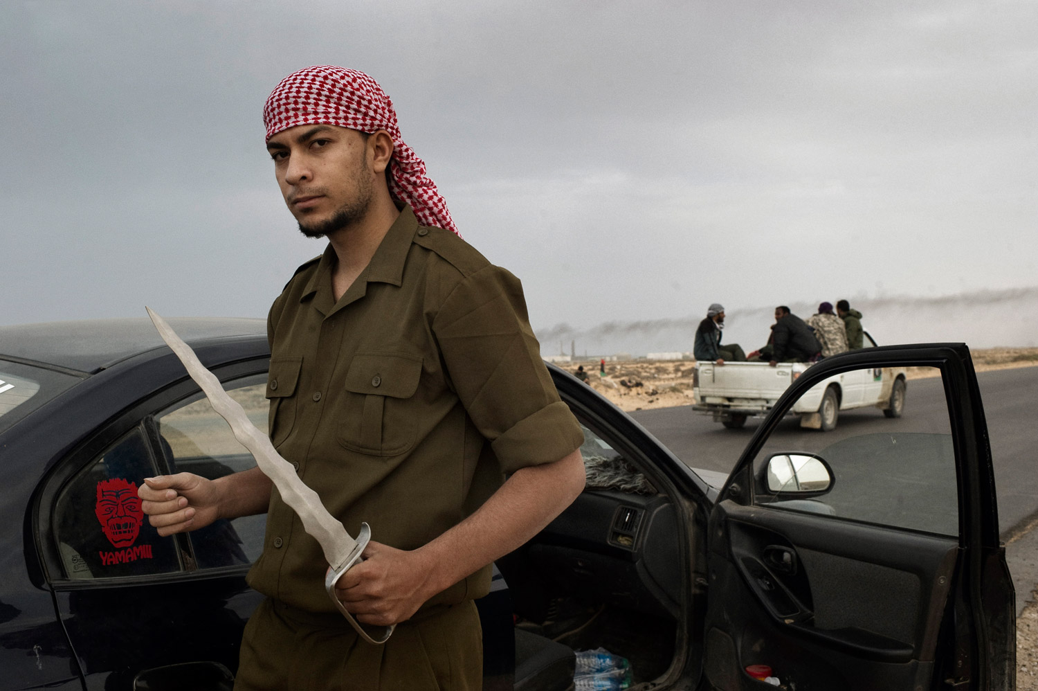 A Libyan rebel soldier, armed with a knife, on the outskirts of Bin Jawad, March 29, 2011.