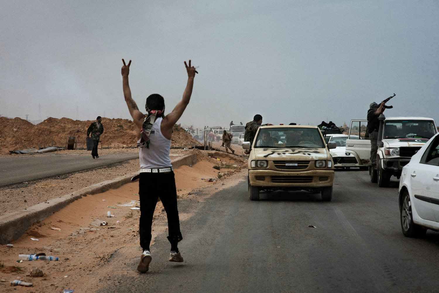 Rebels retreat in a traffic jam of gun trucks and civilian cars outside of Bin Jawad, March 29, 2011.