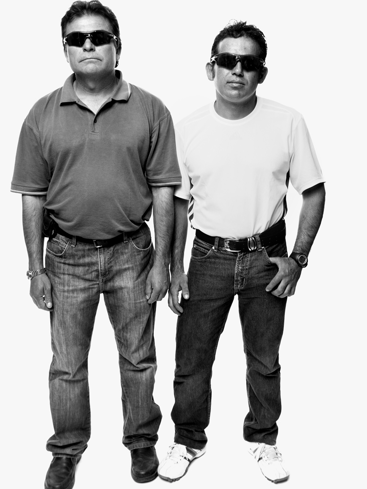 Pablo Rojas and Alex Vega wearing the sunglasses the miners wore to protect their eyes from the light when they emerged from the mine