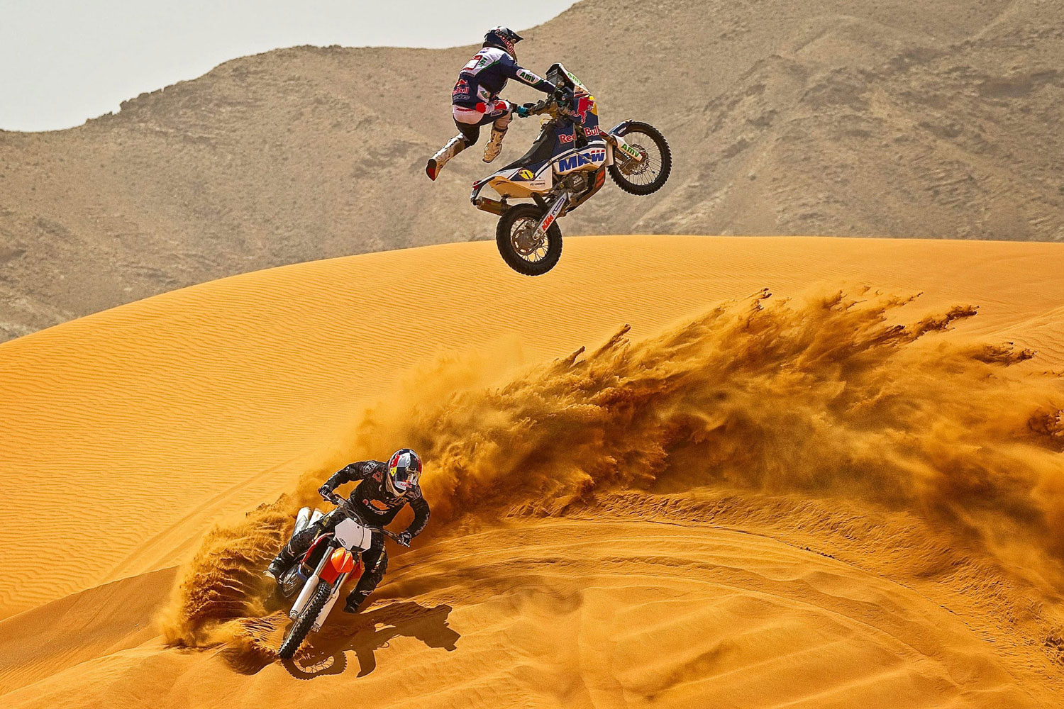 April 13, 2011. Spanish KTM-rider Marc Coma, three-time winner of the Rallye Paris-Dakar, jumping over U.S. Ronnie Renner, winner of the freestyle motocross at the X-Games in the desert close to Dubai in the United Arab Emirates.