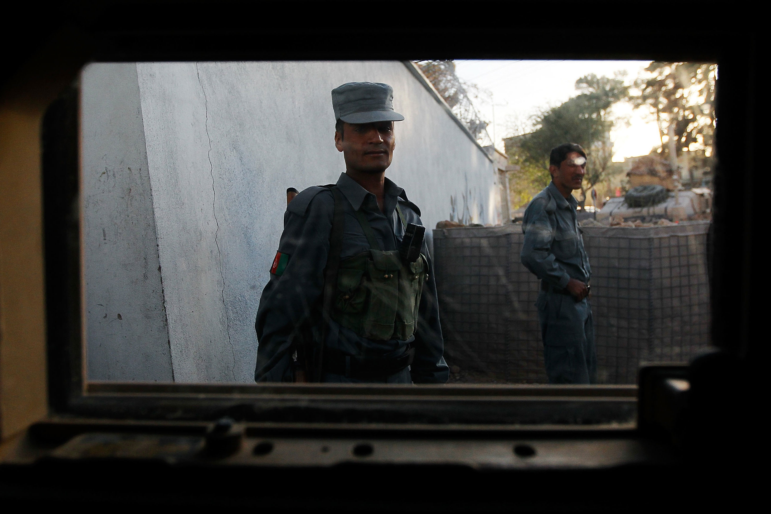 "Herat, Afghanistan ,October 24, 2010:  An Afghan National Policeman from the series ""Iraq and Afghanistan through a HumVee window"". A body of work Hondros was particularly fond of."