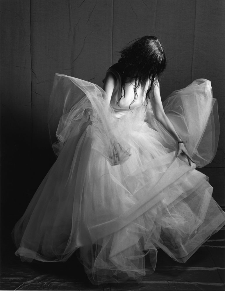 For her German Vogue photo shoot, Bruce Weber asked Smith how she would like to be photographed—She chose a ballerina style ball gown. New York City, 1996