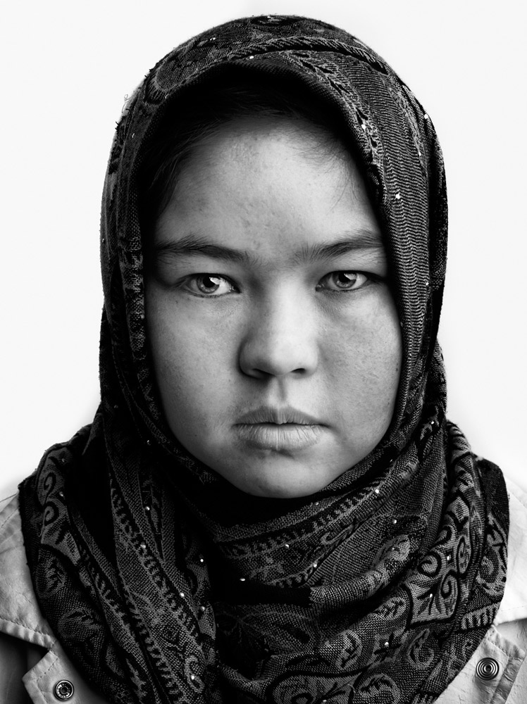 Gulsom, 16, is a student in a tailor shop. She was 5 years old when she lost her leg in a land-mine explosion in Kabul.