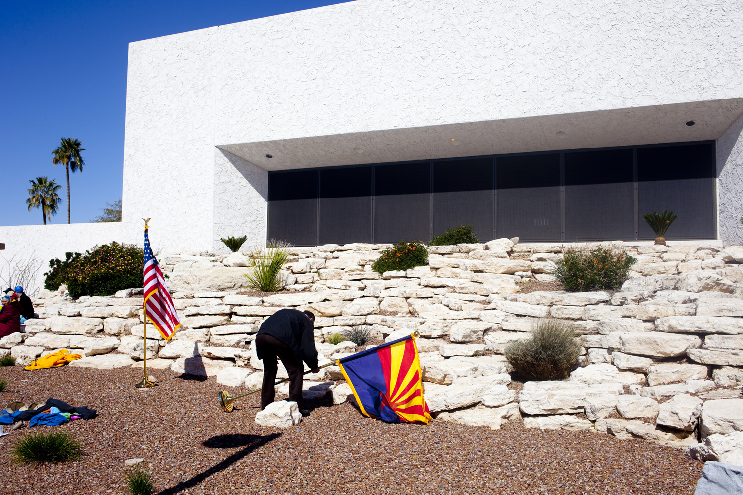 A resident raises the flag at the Bell Recreation Center pool in Sun City, Arizona March 14, 2010.