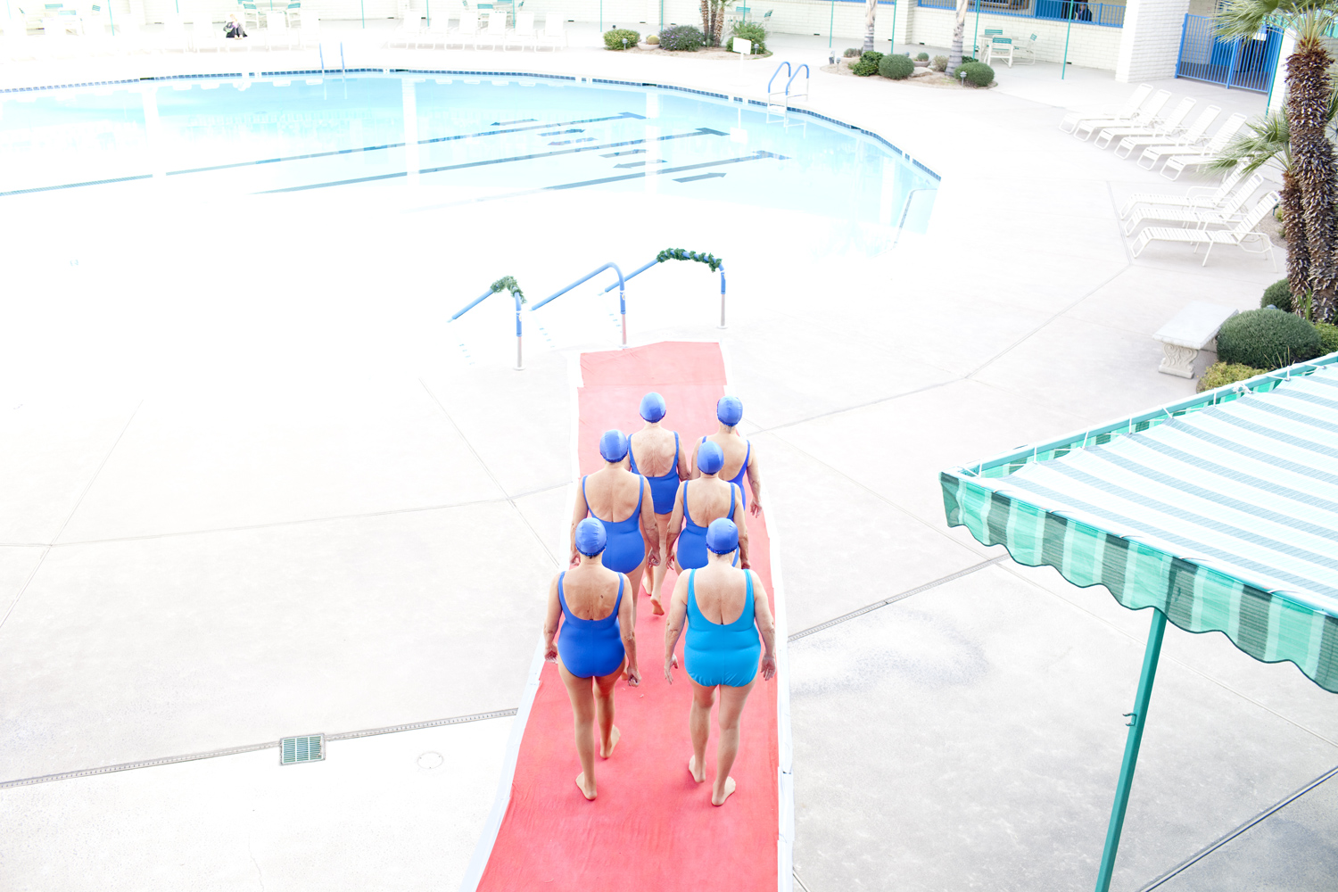 Synchronized swimmers begin a performance at the pool in Sun City, Arizona.
