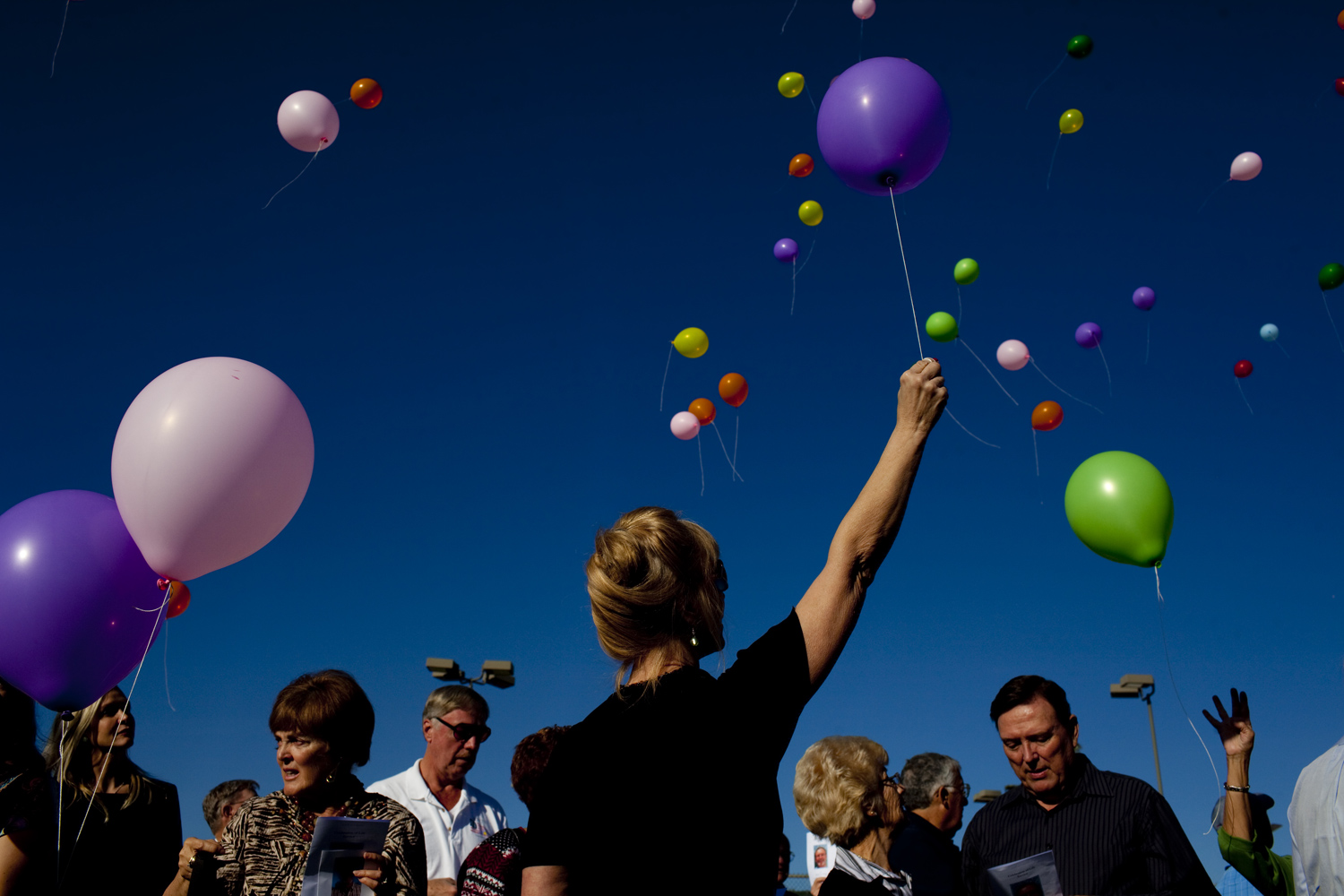 Resident release balloons at the memorial service for Monte Haag, a resident of Sun City, Arizona, who died last year while piloting an ultralight plane.