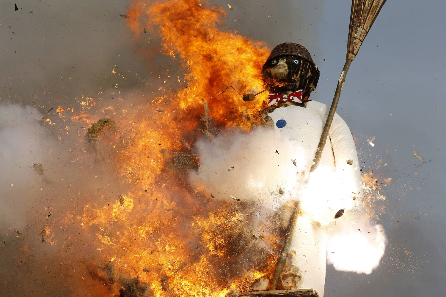 April 11, 2011. The Boeoegg, a snowman made of wadding and filled with firecrackers, explodes atop a bonfire in the Sechselaeuten square in Zurich, Switzerland. As the bells of St. Peter's church chime 6 o'clock, the bonfire below the Boeoegg, which represents winter, is set alight, and mounted guildsmen gallop around the pyre to the tune of the Sechselaeuten March. The faster it catches fire and explodes, the warmer and more beautiful the summer will be.