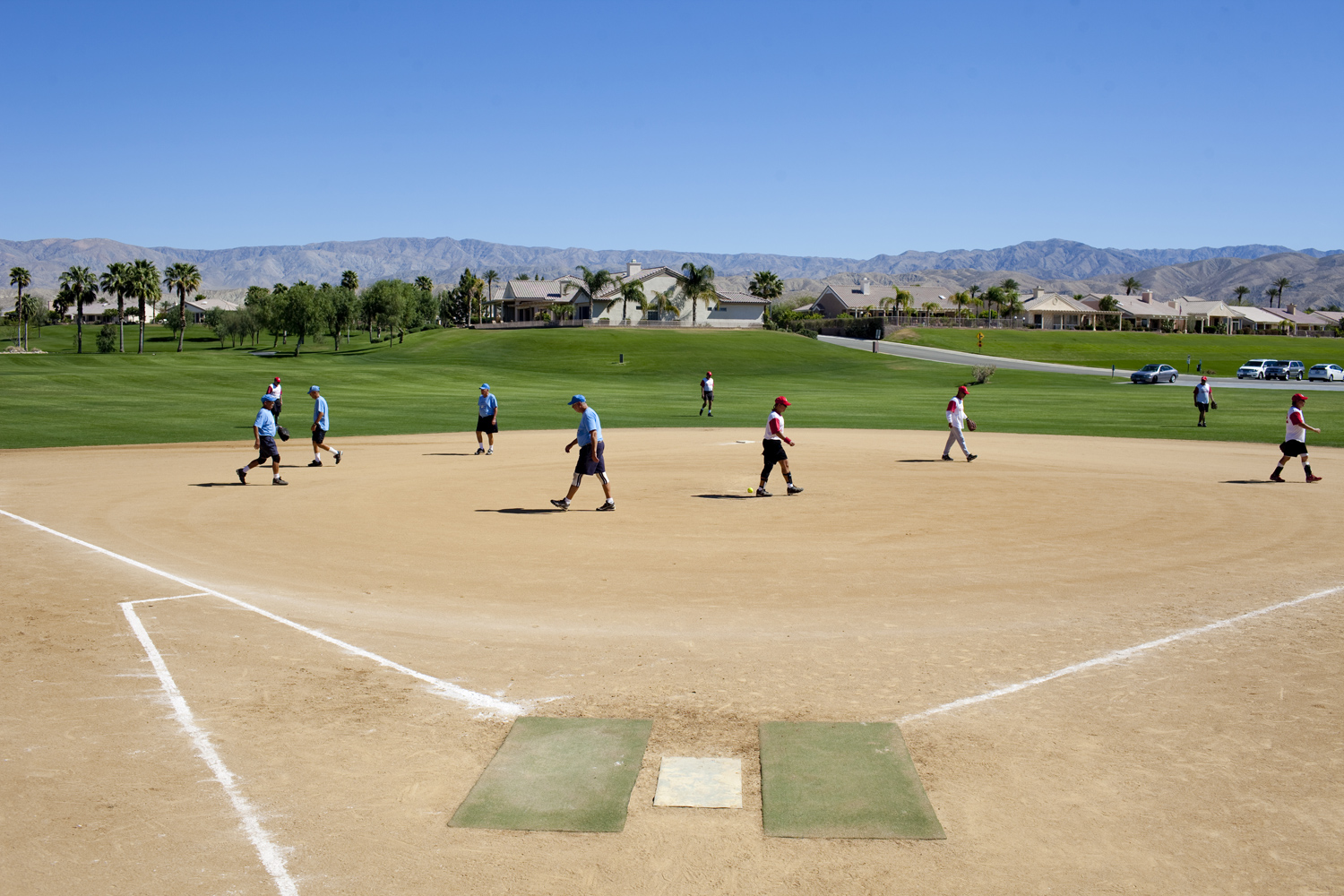 Sun City teams at a softball game, in Indio, California on April 1, 2011. Both teams are made up of retirees 55 and older.