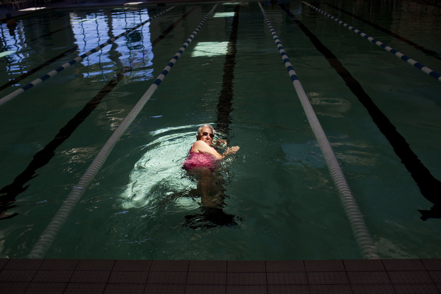 A woman swims laps in a pool at Sun City, Palm Desert on April 1, 2011.
