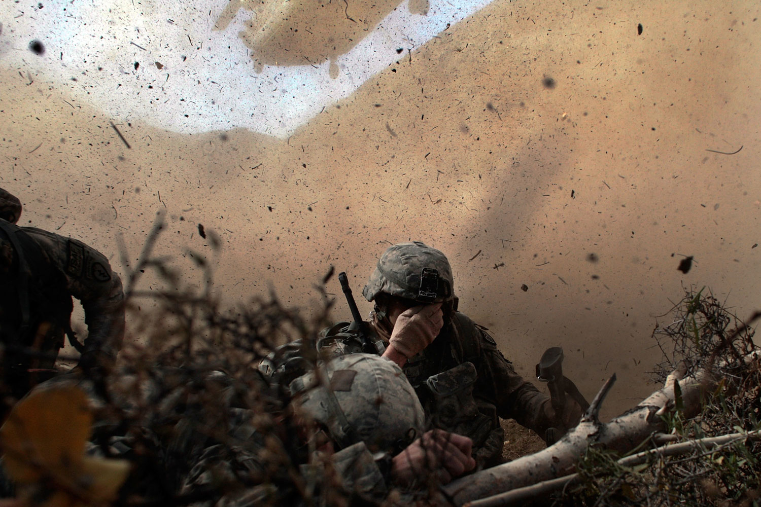 Paktika Province, Afghanistan, October 15, 2009:   US Army soldiers in the 1/501st of the 25th Infantry Division shield their eyes from the powerful rotor wash of a Chinook cargo helicopter as they are picked up from a mission October 15, 2009 in Paktika Province, Afghanistan.