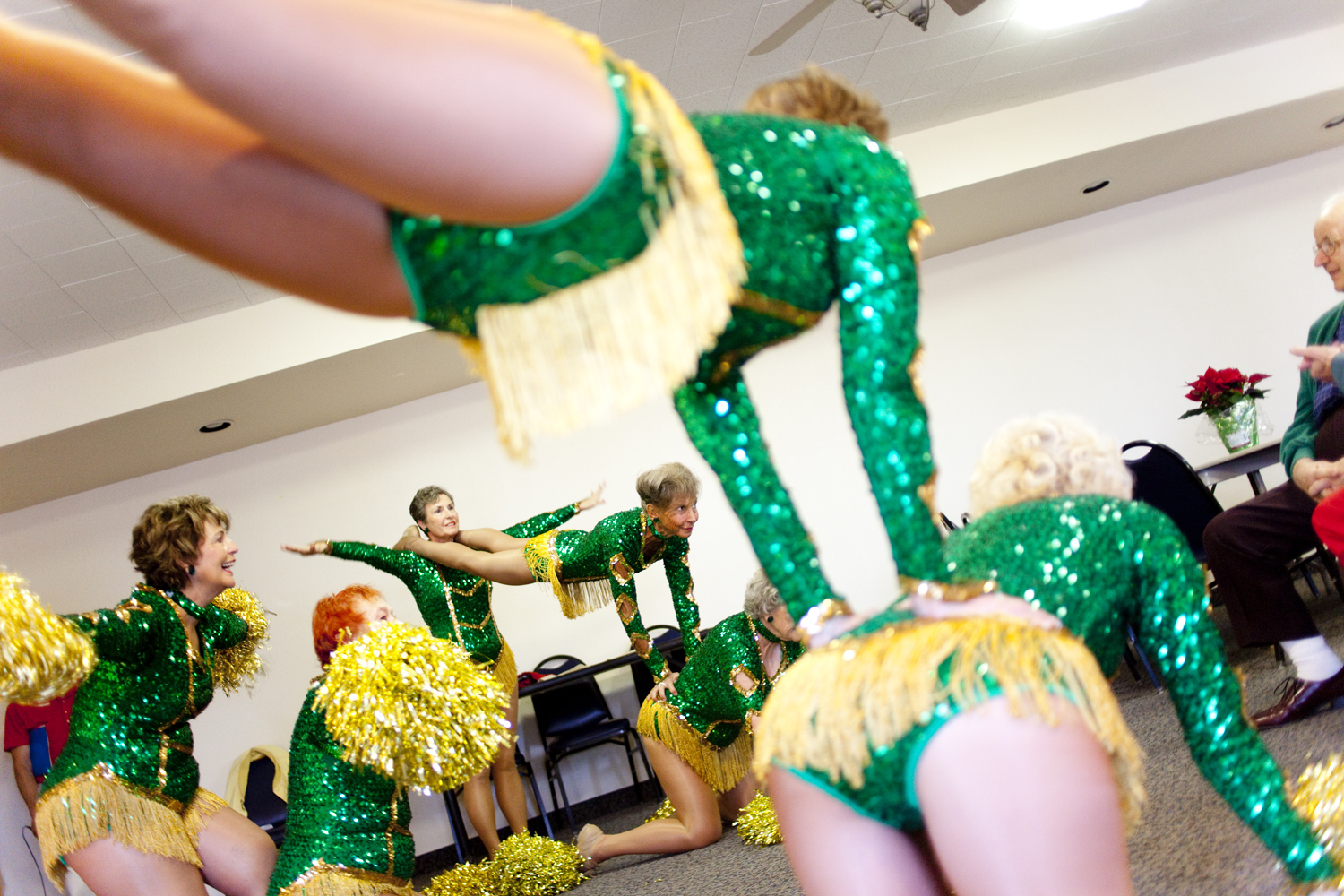 The Sun City Poms, aged 61-78, perform a routine for a crowd in Talisman Hall on December 12, 2009. Their routine includes an announcement that one is  never too old to perform and expand your horizons.