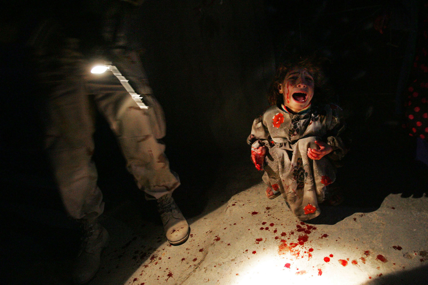 Tal Afar, Iraq, January 18, 2005:  Samar Hassan, 5, screams after her parents were killed by U.S. Soldiers with the 25th Infantry Division. i The troops fired on the Hassan family car when it unwittingly approached them during a dusk patrol in the tense northern Iraqi town. Parents Hussein and Camila Hassan were killed instantly, and a son Racan, 11, was seriously wounded in the abdomen. Racan, paralyzed from the waist down, was treated later in the U.S.