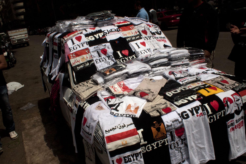 T-shirts celebrating the revolution cover a car near Tahrir Square, April 1, 2011.
