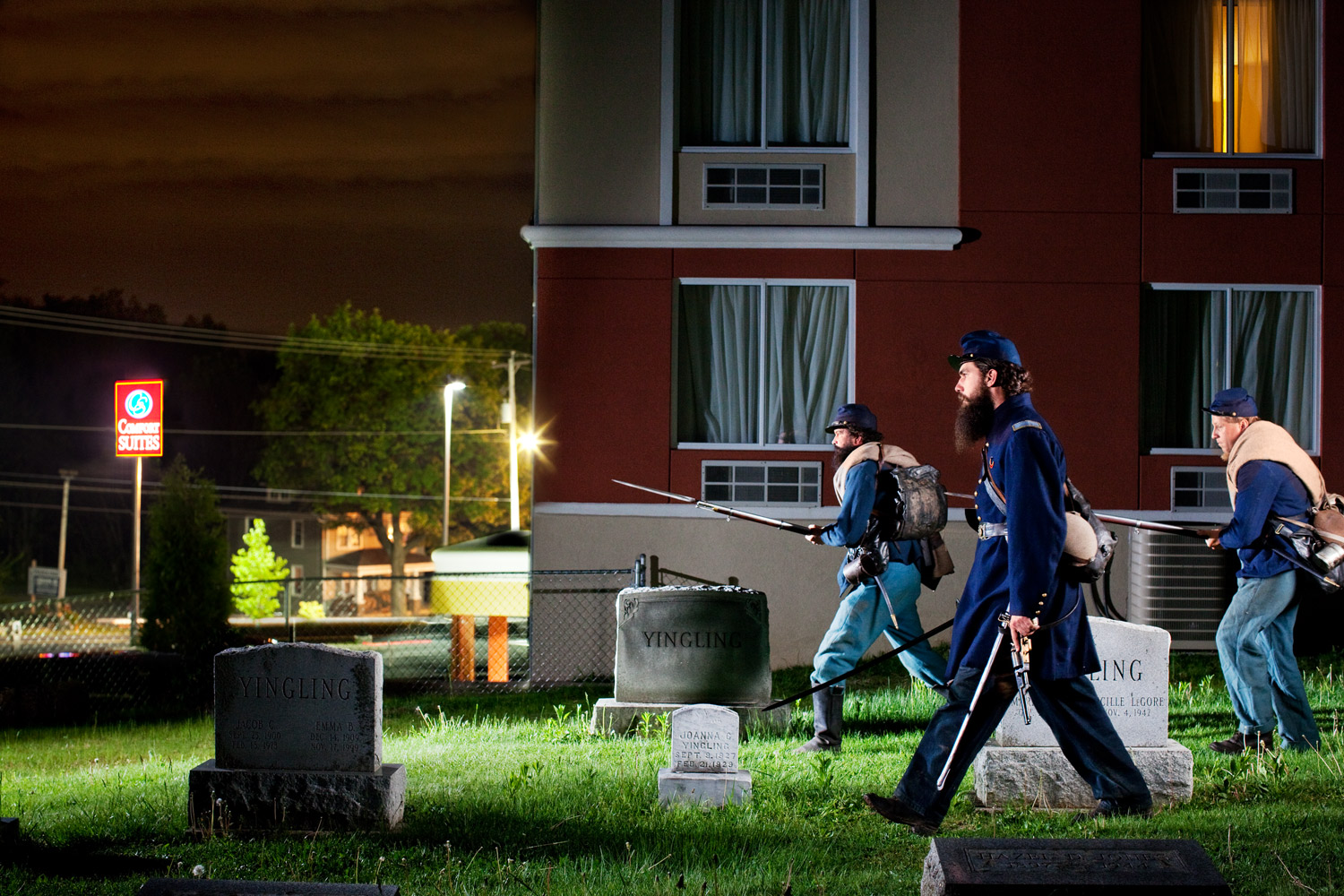 Gettysburg, Pa.                               Robert Lee Hodge, Jerry Hornbaker and Tim Cole advance through the Gettysburg Cemetery. The Comfort Suites was recently built on the battlefield just a few feet from the graves.