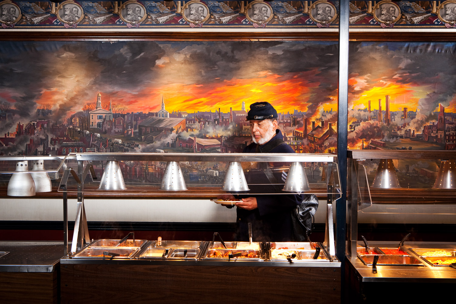 Gettysburg, Pa.                               Charles Hawley gets a bite to eat at General Pickett's Buffet. The mural behind Hawley depicts the collapse of the Confederacy.