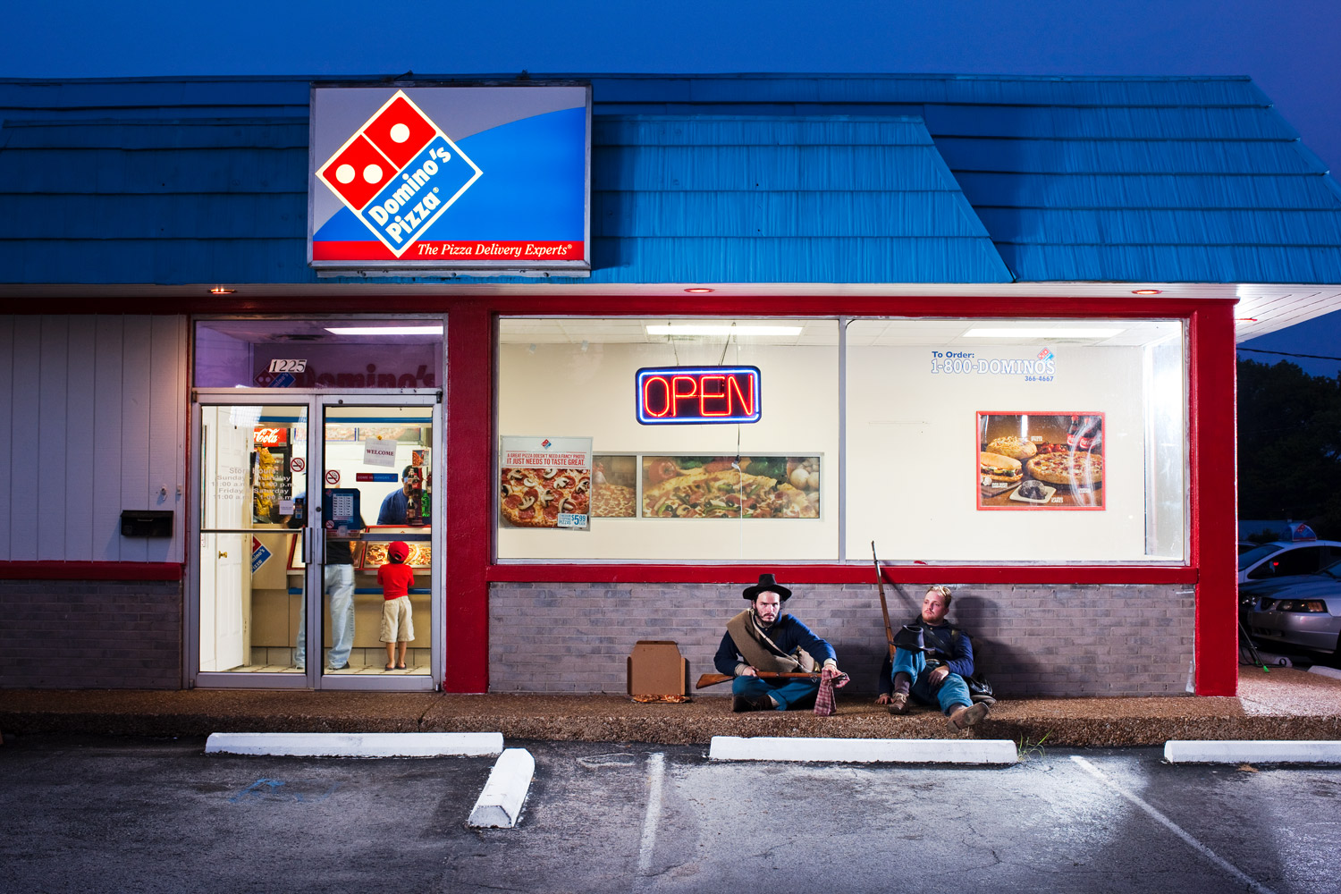 Franklin, Tn.                               Juston Pope and Patrick Landrum sit in front of a Domino's Pizza slated to be bulldozed as part of a recent resurgence in battlefield preservation in the area.
