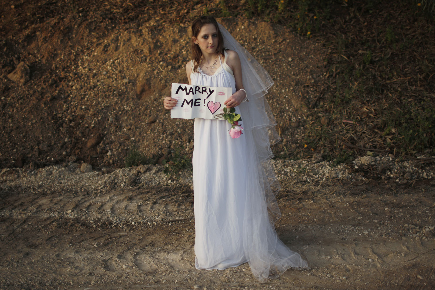 April 14, 2011. Hallel Goldamna, 13, wears a wedding dress as she holds a sign for Canadian singer Justin Bieber ahead of his concert in Tel Aviv, Israel.