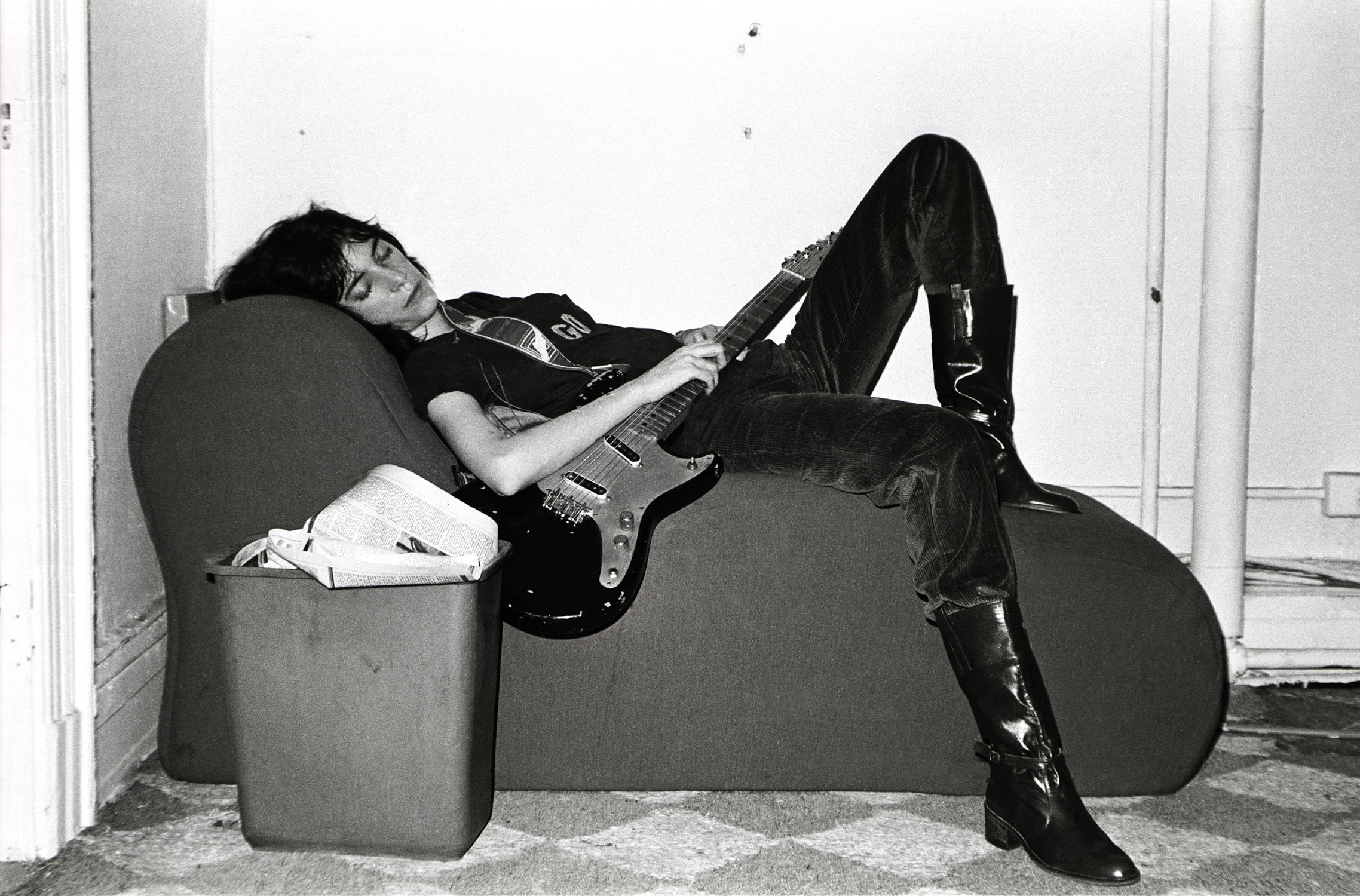 Taking a nap with her first electric guitar, a Fender Duo-Sonic, while rehearsing for a tour, 1976