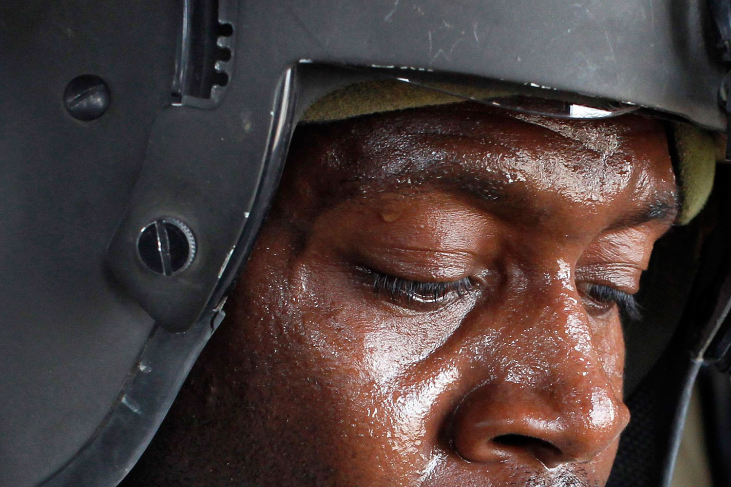 April 8, 2011. U.S. Army medic Tyrone Jordan of the 101st Combat Aviation brigade, aboard a medevac helicopter in Helmand province in Afghanistan, treats a Marine wounded by a gunshot. Several soldiers were killed in early April by friendly fire in Helmand.