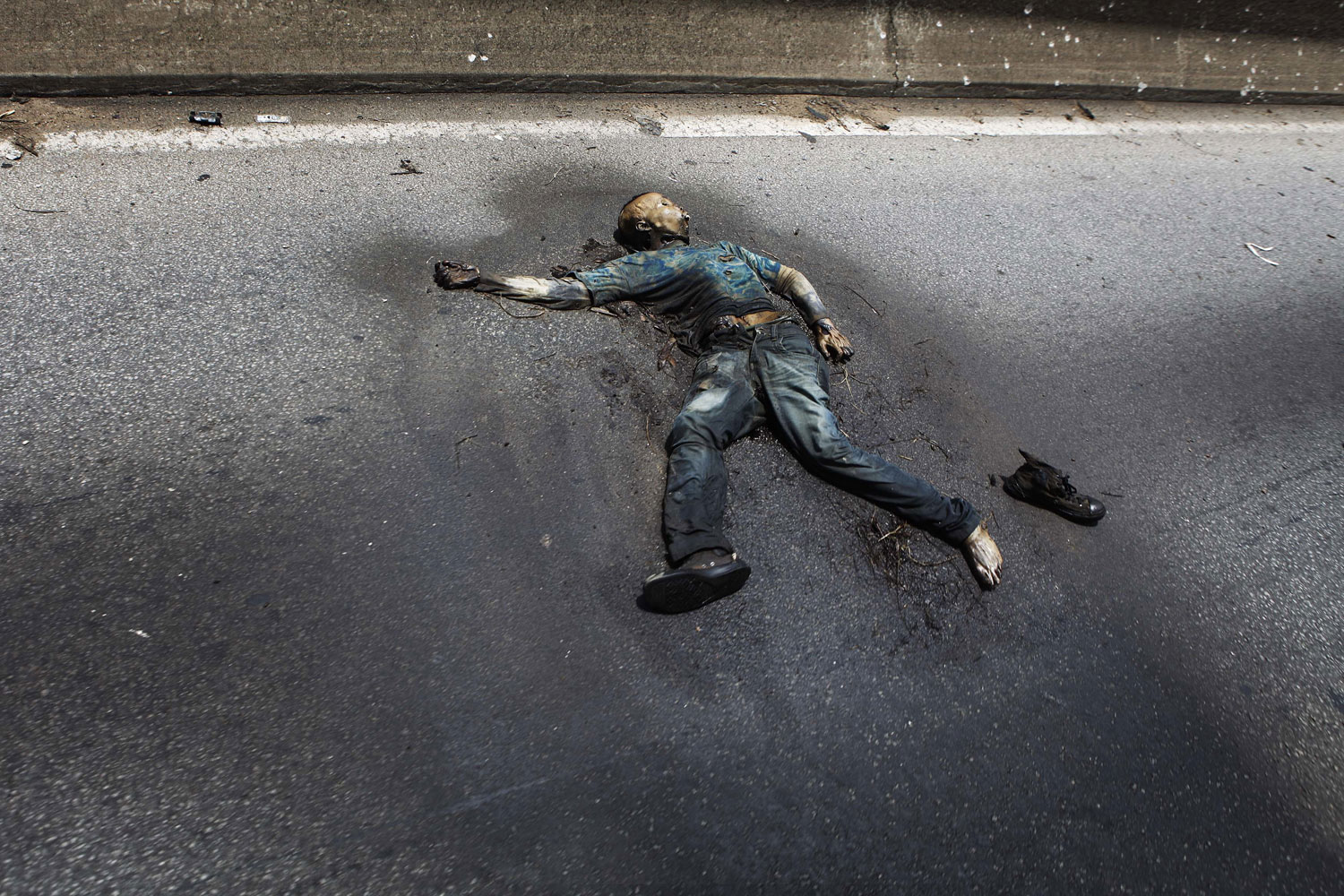 April 14, 2011. A decomposing body lies on a road in Abidjan. Ivory Coast's Laurent Gbagbo was overthrown by Ivorians, not by foreign powers, the United Nations said on Thursday amid rising criticism of its role in the removal of the former leader.