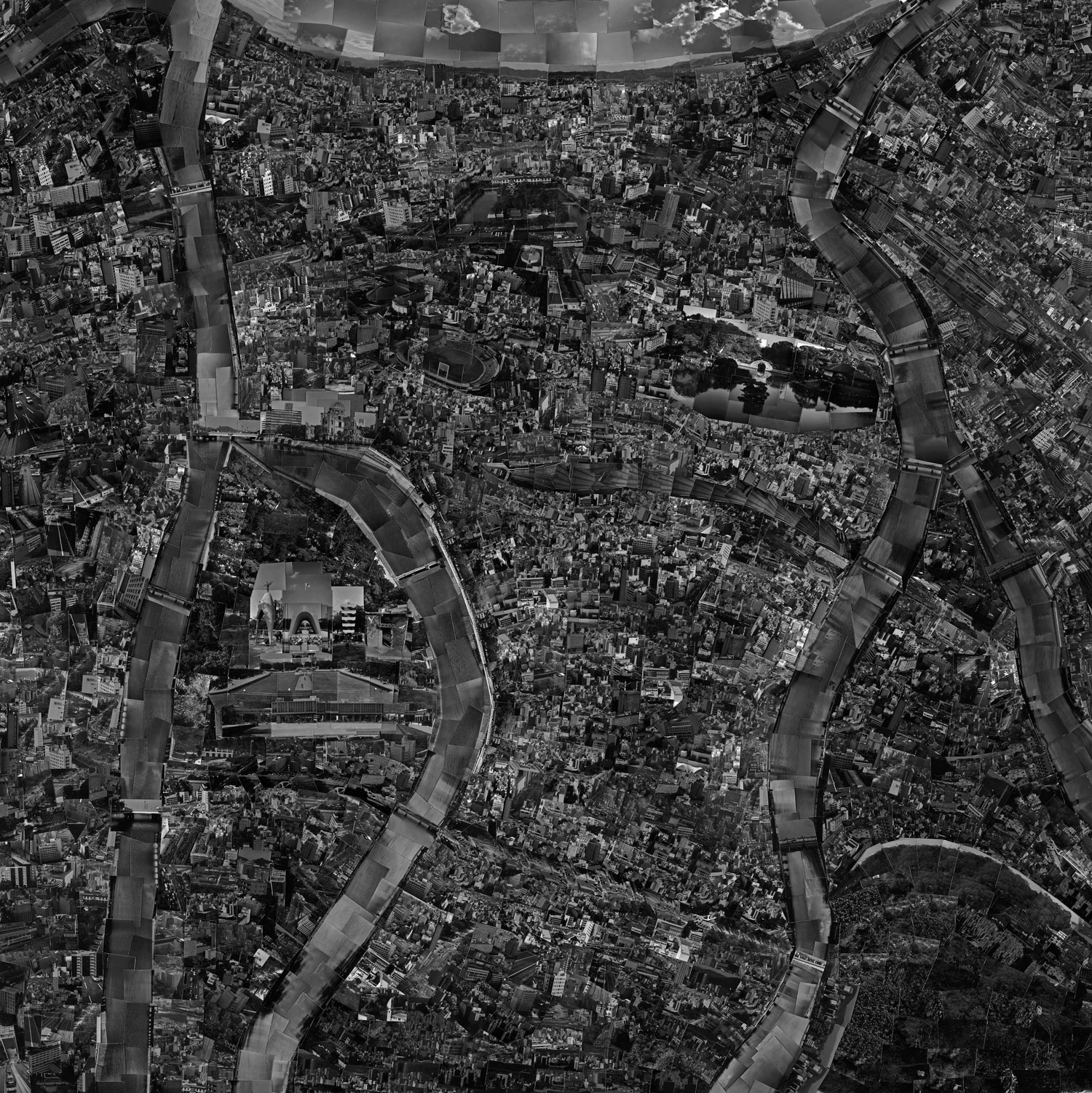 Diorama Map Hiroshima, 2003:  Hiroshima is situated as one of the most important cities in Japanese history. While I walked there, I thought about how the city recovered after the atomic bomb and tried to feel the atmosphere. Also, as I observed the city along the side of the river, the atmosphere intensified. The volume of the river in this work has consequently increased.