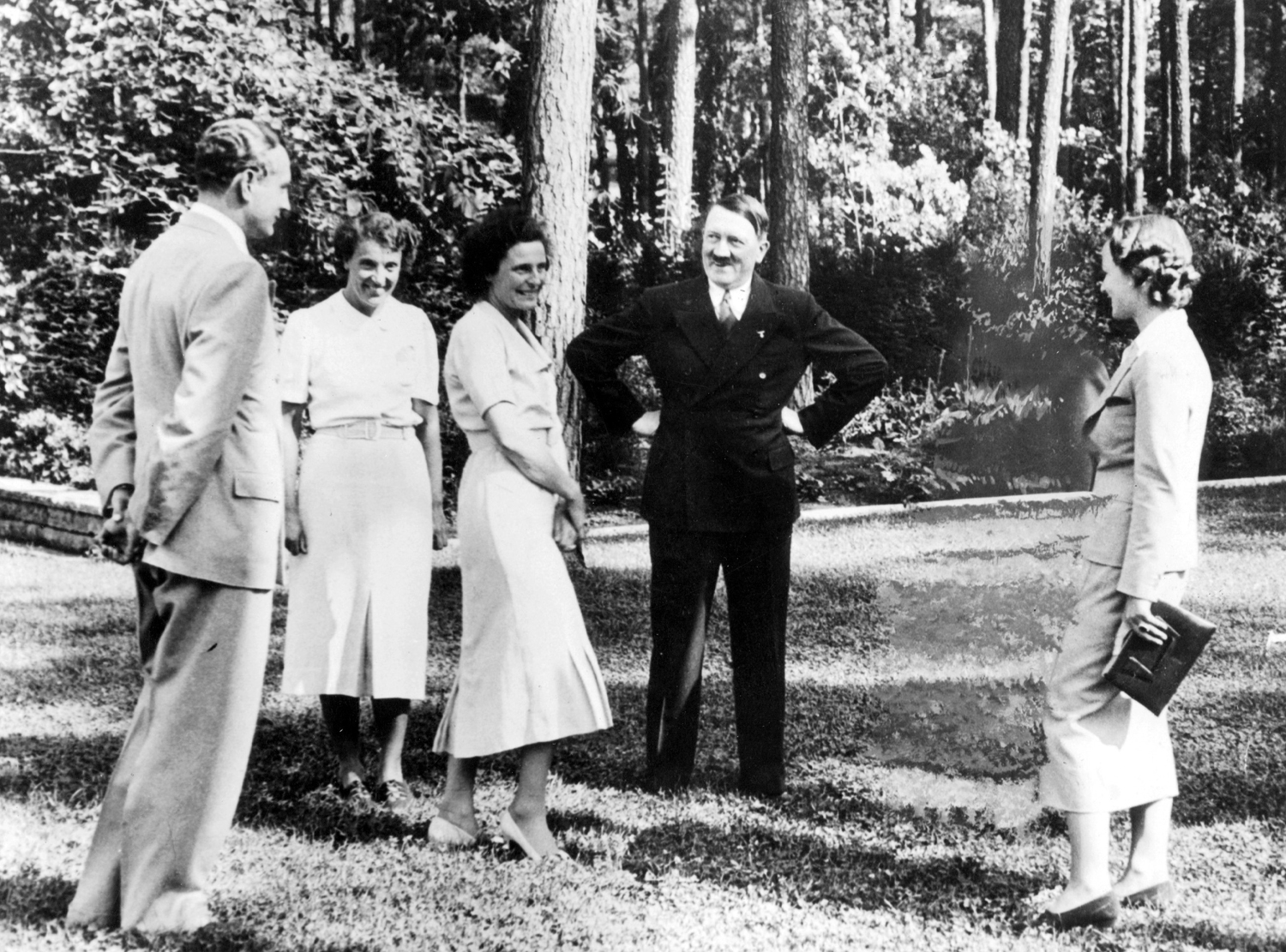 Hitler Meets with Leni Riefenstahl, 1937                               The Nazi filmmaker, center, is visited by the Führer in Berlin. They are joined by, at far left, her brother Heinz, and at far right, his wife Ilse. Note the ghostly outline next to Ilse in the middle right of the frame.
