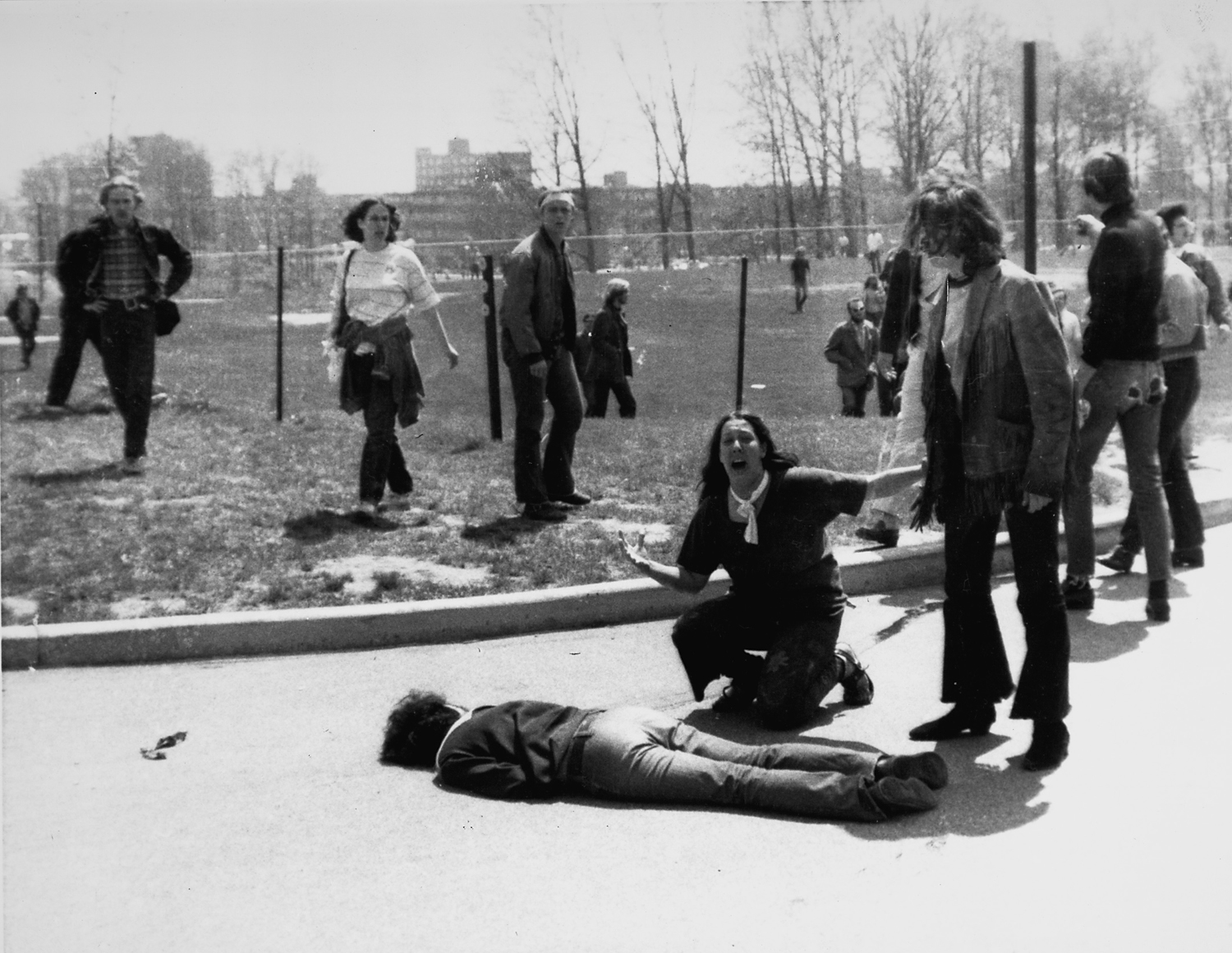 The Original Image                               For all its drama, the Kent State photo violated one of the cardinal rules of photographic composition: the fence post in the field behind Vecchio terminates at the top of her head, almost as if a giant nail has fallen into her skull. When the image was published in Life magazine that week, the editors opted to remove it.