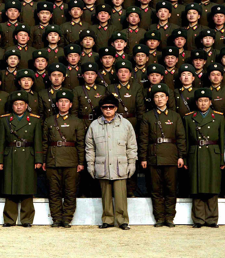 Kim Jong Il and North Korean Troops, c. 2009                               Western observers of the PRK have long suspected that the photographs released by KCNA, North Korea's official news agency, are routinely manipulated to portray leader Kim Jong Il in the best possible light. This group photo, released in the wake of rumors that Kim had suffered a stroke, was closely scrutinized for inconsistencies. It purports to show him in the company of an honored regiment.