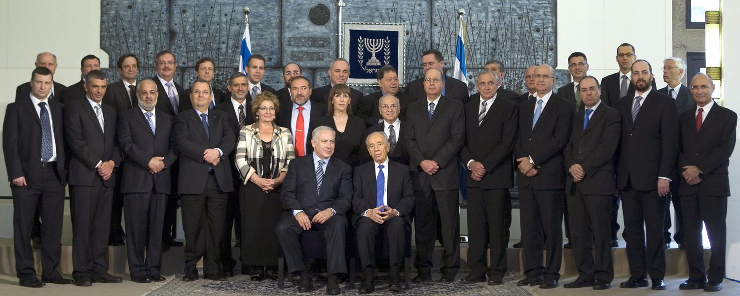 The Original Image                               An unaltered version of the photo reveals that the newspaper has replaced the two female Cabinet members, Limor Livnat and Sofa Landver, with men's faces. The faces belong to ministers Ariel Atias and Moshe Kachlon, who in the original photograph can be seen toward the periphery of the group (standing, second from left and second from right). In Yated Neeman's version of the image, they have been cropped out. Much of the newspaper's readership consists of ultra-Orthodox readers who do not think it proper for women to serve in the government.