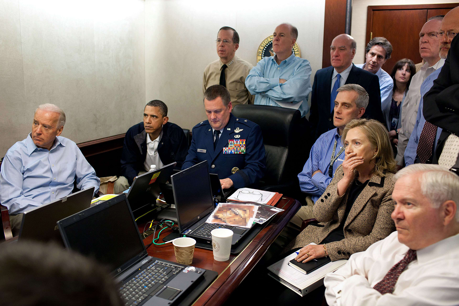"""The White House Situation Room, May 1, 2011                               This photograph, from inside the President's """"war room,"""" shows the Commander in Chief and key members of his national security team watch live intelligence as US forces assault a Osama bin Laden's compound within Pakistan. On the center of the table, in front of Secretary of State Hillary Clinton, sits a classified document that was obscured by the White House before it was released to the press."""
