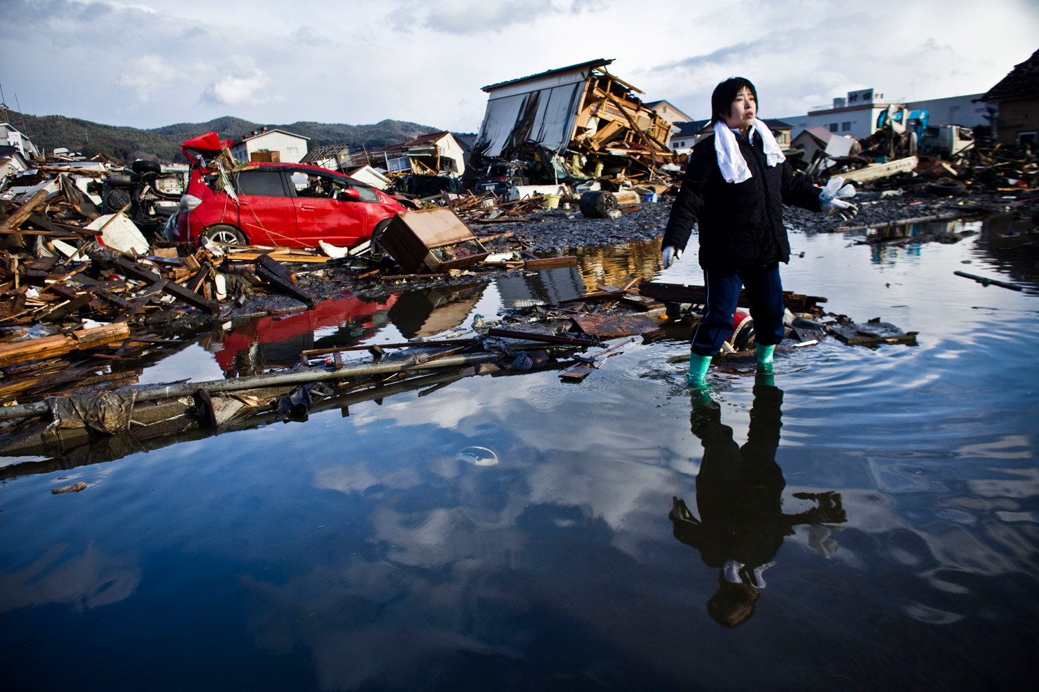 Chieko Chiba looks for the remains of her house in Kesennuma, Miyagi prefecture.  Everything is gone,  she said.