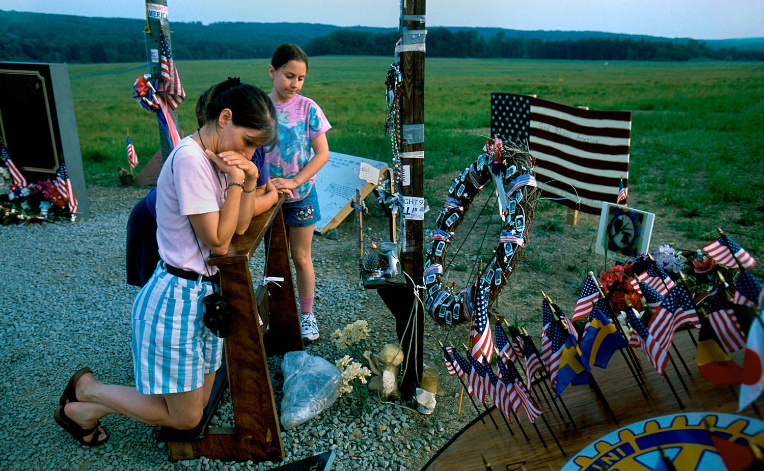 A tourist pauses at the temporary memorial for Flight 93 in Shanksville, Pa.