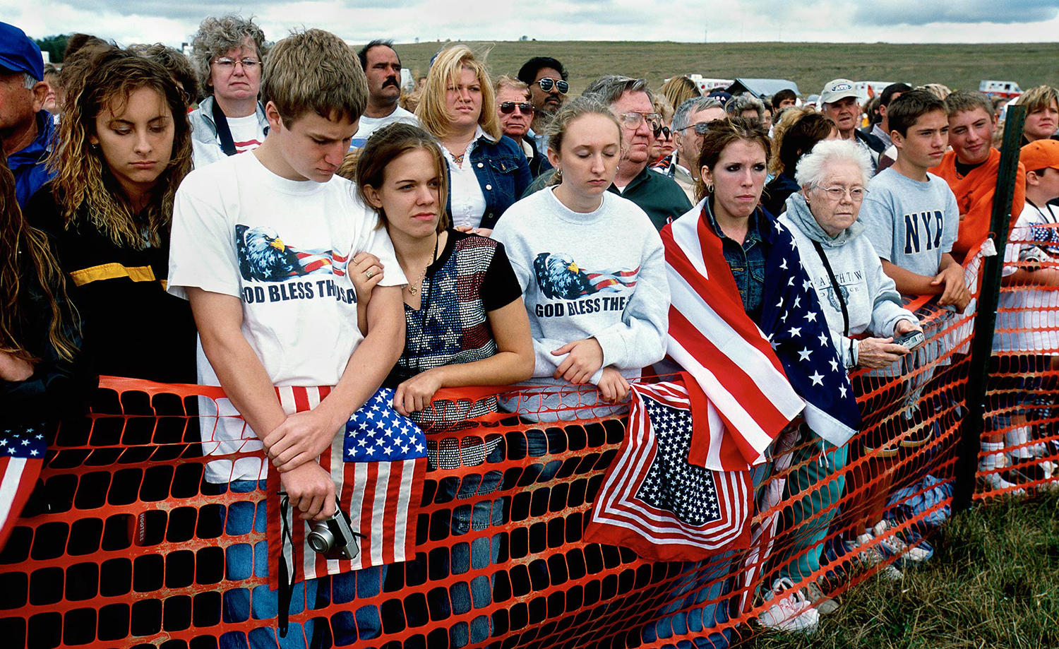 Residents and tourists gather during the ceremony for the one year anniversary of the crash of Flight 93, Shanksville, Pa.