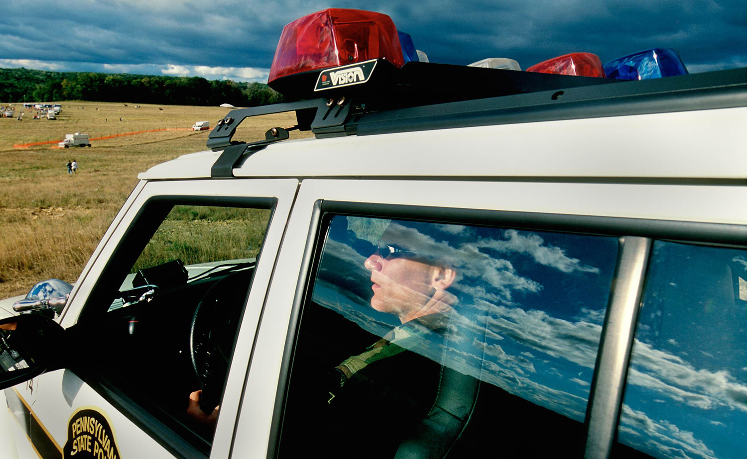 A police officer looks out upon the crash site of Flight 93 during the one year anniversary of 9/11.