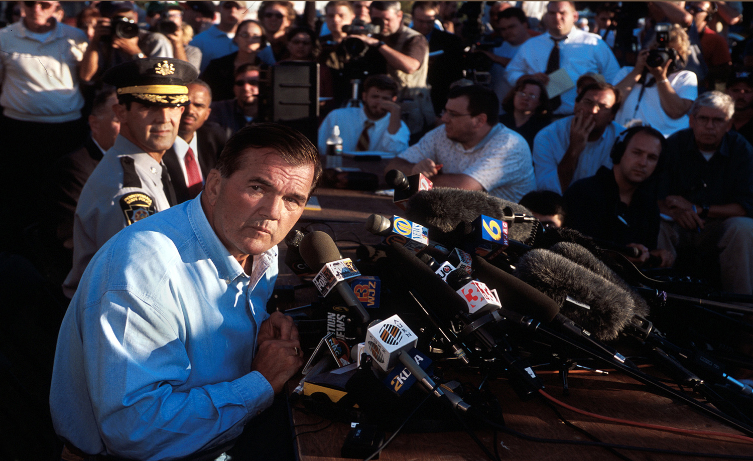 Governor Tom Ridge's press conference at sunset in a soybean field in Shanksville, Pa., Sept. 11, 2001.