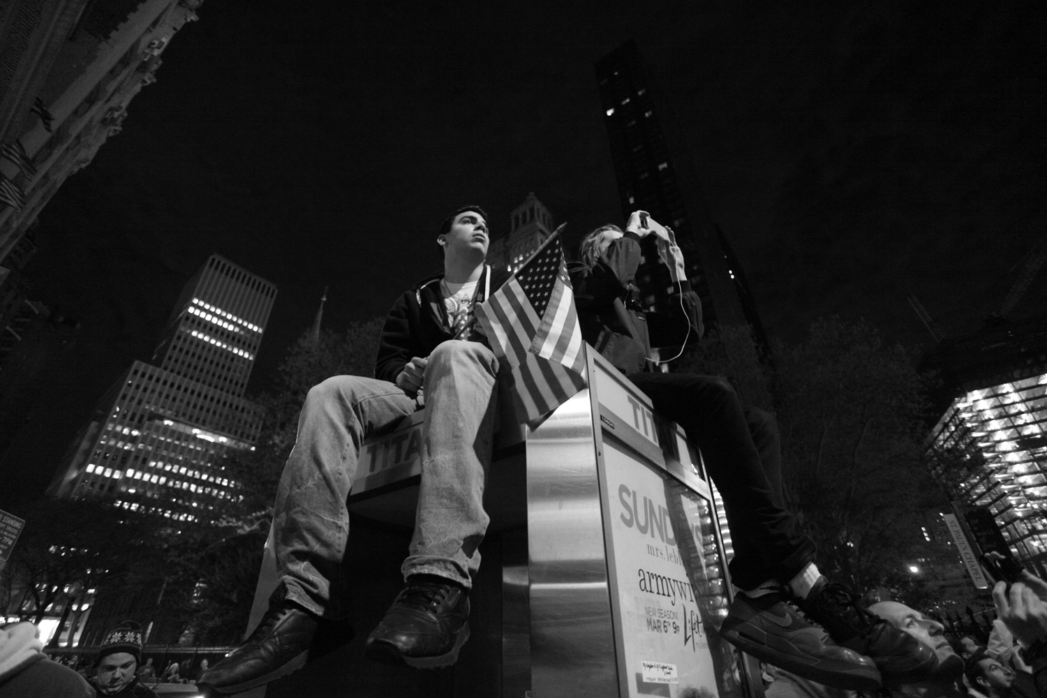 20-year-old Chris Lombari, the son of a firefighter from Staten Island, climbed on top of a phone booth to cheer on the crowd and reflect on the night.