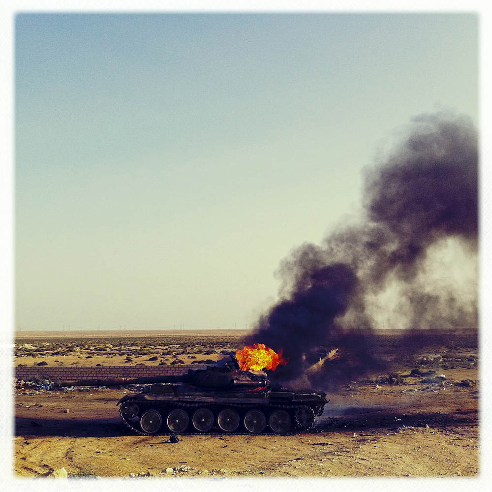 Burning Libyan government tank, Brega, Libya, March 26, 2011.
