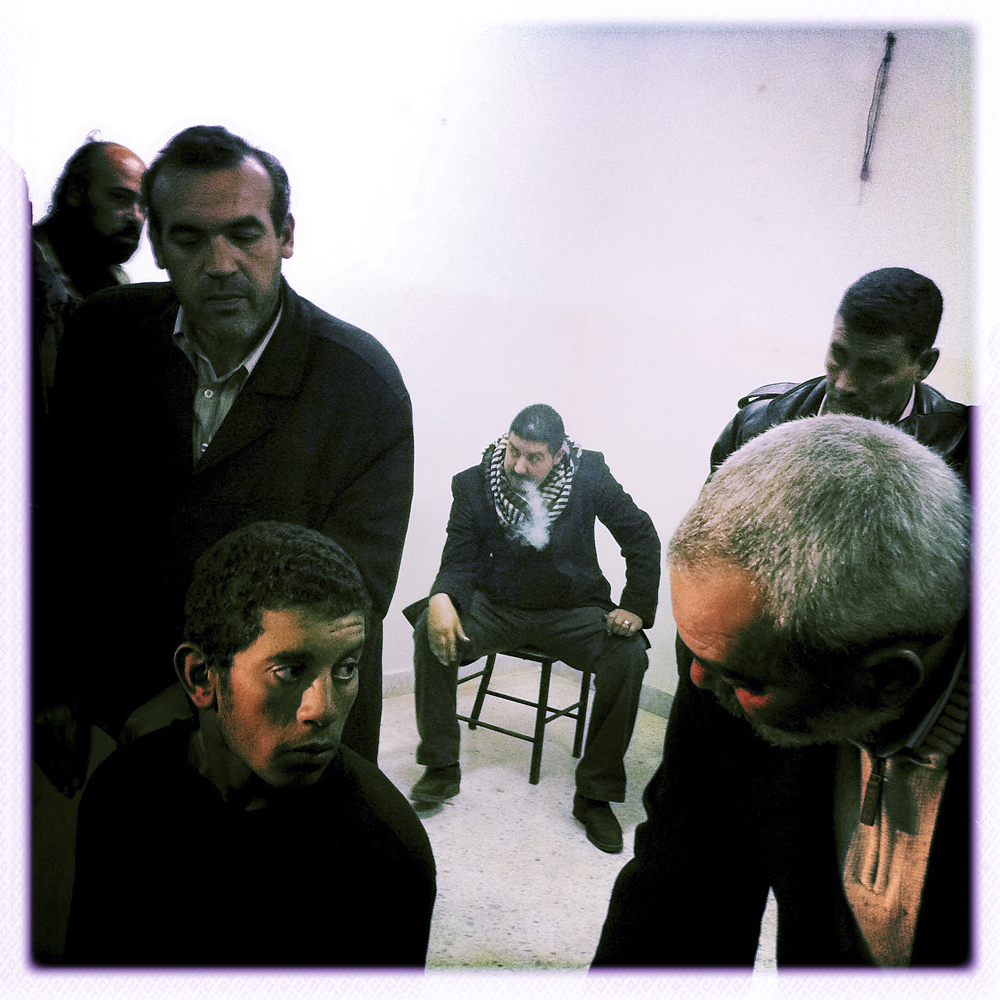 A government soldier, bottom left, is questioned in Benghazi, Libya, April 1, 2011.